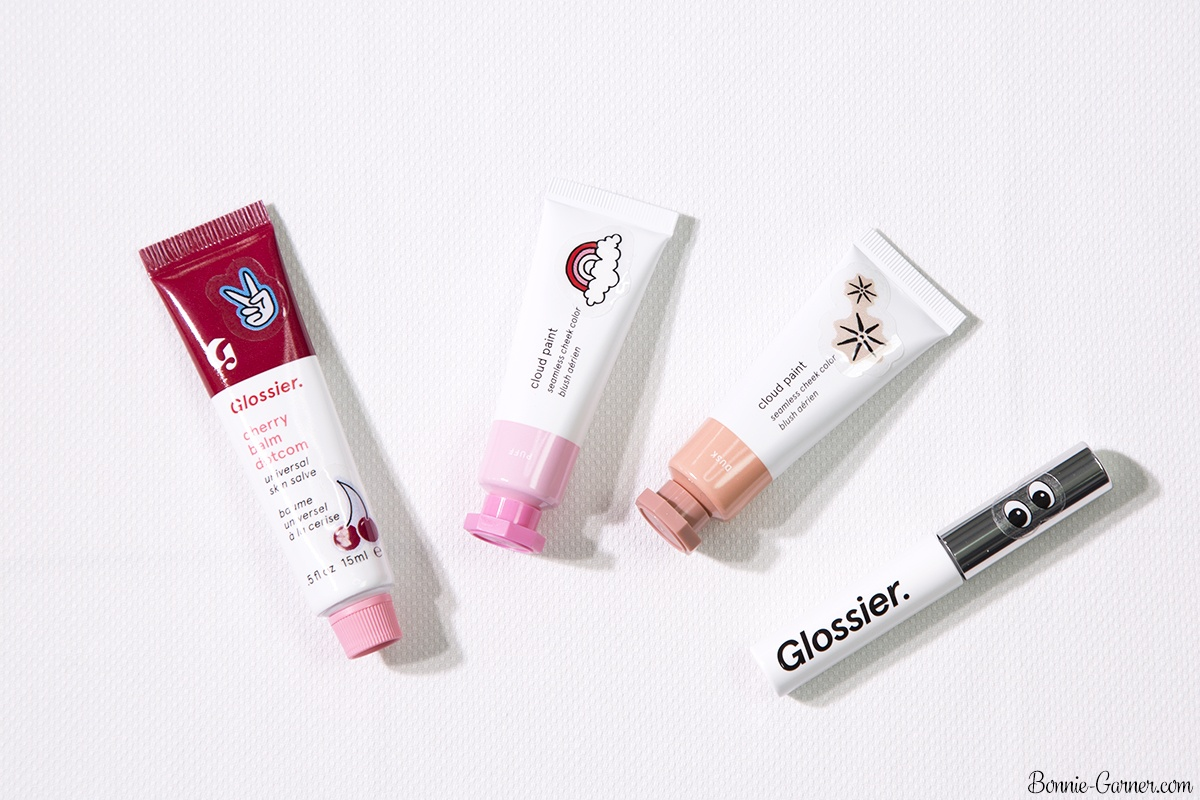 Glossier: Cloud Paint Dusk, Puff; Balm Dotcom Cherry; Boy Brow Brown